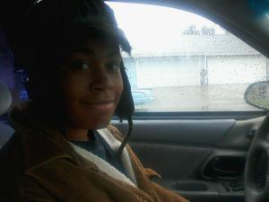 Lani driving in the rain