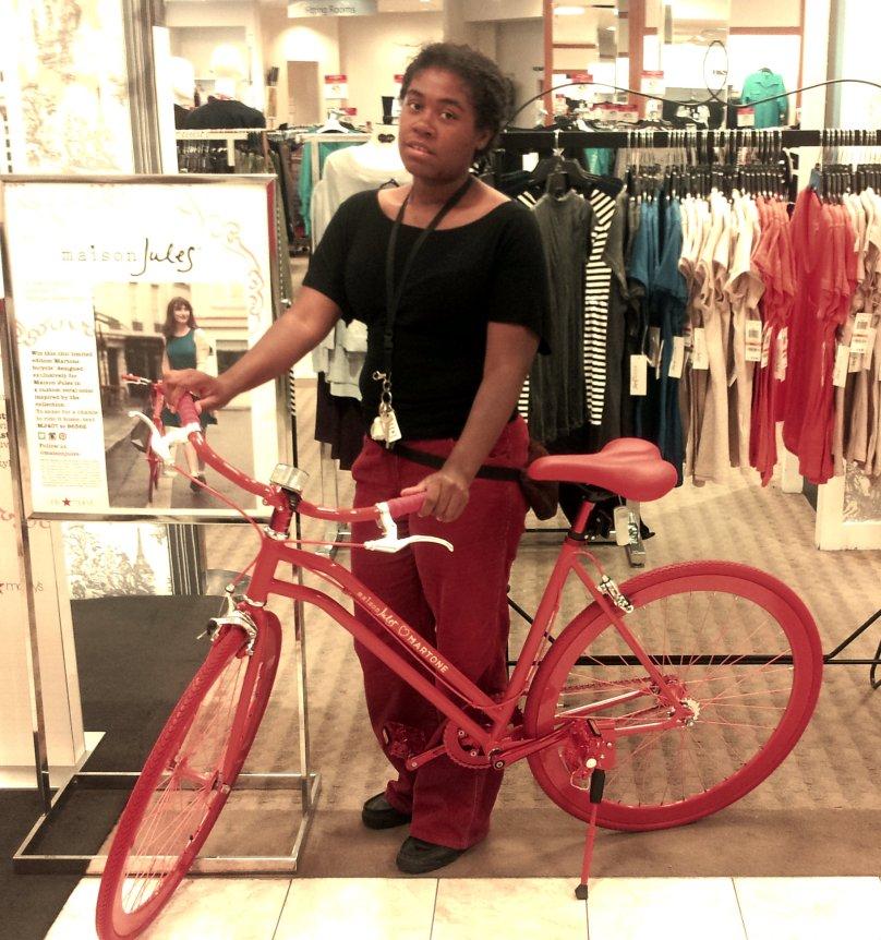 Lani posing with bike at Macy's